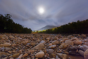 The moon engulfed in clouds at 1:20 AM along the East Branch of the Pemigewasset River along the Kancamagus Scenic Byway in Lincoln, New Hampshire.