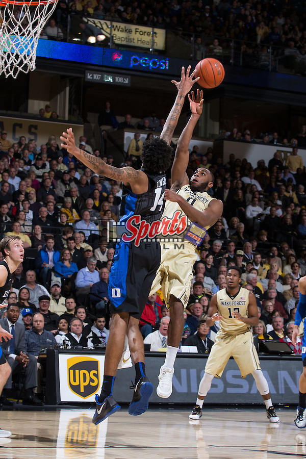 Codi Miller-McIntyre (0) of the Wake Forest Demon Deacons floats a shot over Brandon Ingram (14) of the Duke Blue Devils during first half action at the LJVM Coliseum on January 6, 2016 in Winston-Salem, North Carolina.  The Blue Devils defeated the Demon Deacons 91-75.   (Brian Westerholt/Sports On Film)