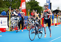 Photo: Richard Lane/Richard Lane Photography. British Triathlon Super Series, Parc Bryn Bach. 18/07/2009. .Swimming to cycling in the transition area during in the Women's Elite Race transition area.