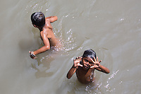 Children Swimming in the Bungamati River at Pashupatinath, Nepal