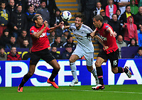 Swansea's Michu held off the ball by Nemanja Vidic and Rio Ferdinand.<br />