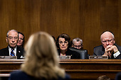 UNITED STATES - SEPTEMBER 27: From left, Sen. Chuck Grassley, R-Iowa, Sen. Dianne Feinstein, D-Calif., and Sen. Patrick Leahy, D-Vt., listen as Dr. Christine Blasey Ford testifies during the Senate Judiciary Committee hearing on the nomination of Brett M. Kavanaugh to be an associate justice of the Supreme Court of the United States, focusing on allegations of sexual assault by Kavanaugh against Christine Blasey Ford in the early 1980s. (Photo By Tom Williams/CQ Roll Call/POOL)