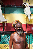JAMAICA, Port Antonio. A rastafari and his beach shack at the Winnifred Beach.