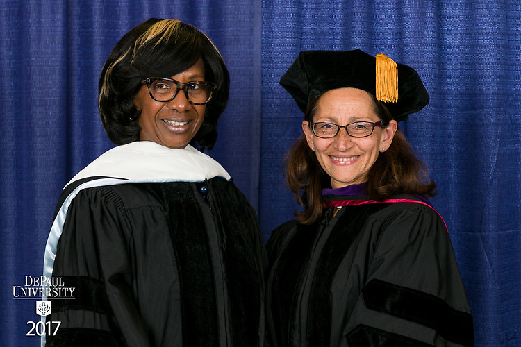 Paulette Brown, honorary degree recipient and commencement speaker, left, and Jennifer Rosato Perea, dean of the College of Law. DePaul University College of Law held its commencement ceremony, Sunday, May 14, 2017, at the Rosemont Theatre in Rosemont, IL, where some 240 students received their Juris Doctors or Master of Laws degrees. (DePaul University/Jeff Carrion)