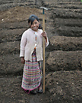 A girl poses as school children prepare garden plots and plant vegetables in San Jose la Frontera, a small Mam-speaking Maya village in Comitancillo, Guatemala. The program is jointly sponsored by the community's school and the Maya Mam Association for Investigation and Development (AMMID).