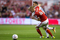 Joe Worrall of Nottingham Forest battles with Lee Gregory of Millwall during the Sky Bet Championship match between Nottingham Forest and Millwall at the City Ground, Nottingham, England on 4 August 2017. Photo by James Williamson / PRiME Media Images.