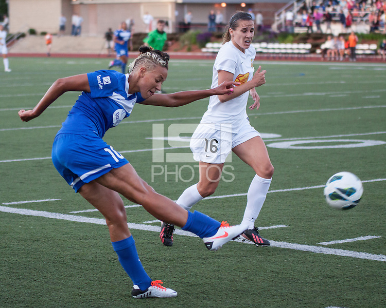 In a National Women's Soccer League Elite (NWSL) match, the Boston Breakers defeated the Western New York Flash  2-1, at Dilboy Stadium on May 5, 2013.  Boston Breakers forward Lianne Sanderson (10) kicks a cross as Western New York Flash defender Katherine Reynolds (16) tries to intercept.