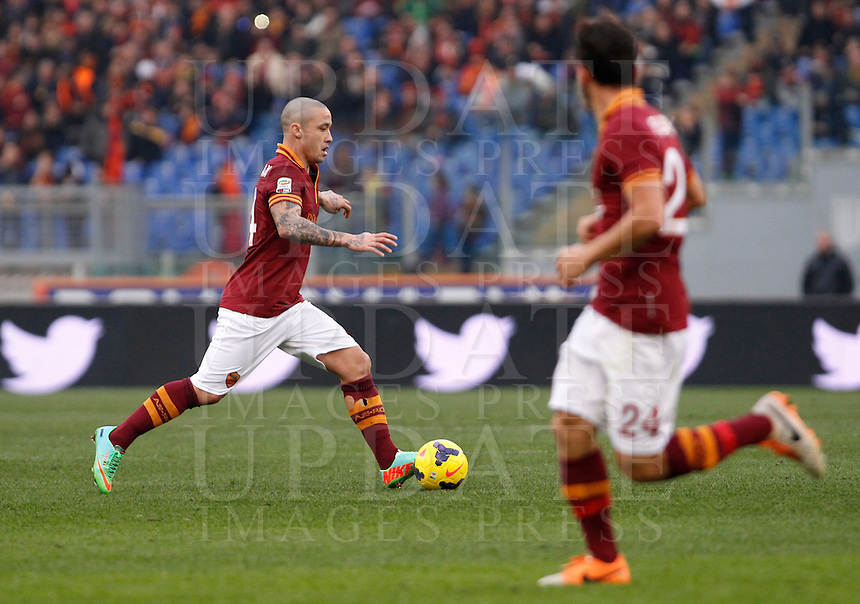 Calcio, Serie A: Roma-Genoa. Roma, stadio Olimpico, 12 gennaio 2014.<br /> AS Roma midfielder Radja Nainggolan, of Belgium, in action past teammate Alessandro Florenzi, right, during the Italian Serie A football match between AS Roma and Genoa, at Rome's Olympic stadium, 12 January 2014. <br /> UPDATE IMAGES PRESS/Isabella Bonotto