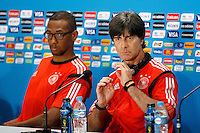 Germany manager Joachim Low looks like a ninja and Jerome Boateng looks surprised during the press conference