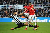 Jamaal Lascelles of Newcastle United battles with Jesse Lingard of Manchester United during Newcastle United vs Manchester United, Premier League Football at St. James' Park on 11th February 2018
