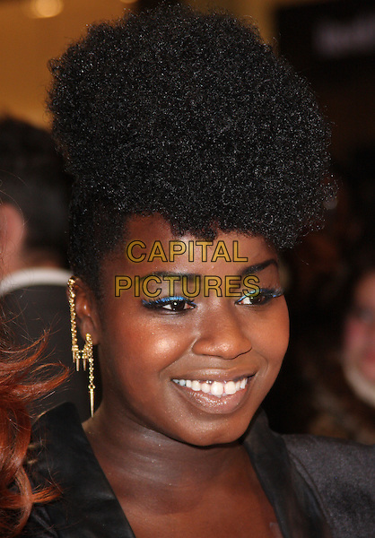 Misha Bryan.'The Twilight Saga: Breaking Dawn - Part 1' UK film premiere at Westfield Stratford City, London, England..16th November 2011.headshot portrait gold chain earring blue eyeshadow make-up.CAP/ROS.©Steve Ross/Capital Pictures.