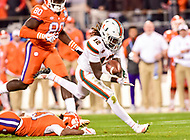 Charlotte, NC - DEC 2, 2017: Miami Hurricanes defensive back Malek Young (12) tries to scoop up a Clemson fumble during ACC Championship game between Miami and Clemson at Bank of America Stadium Charlotte, North Carolina. (Photo by Phil Peters/Media Images International)