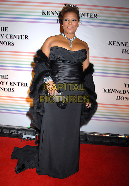 QUEEN LATIFAH .31st Kennedy Center Honors celebrating lifetime achievement in the performing arts held at the Kennedy Center for the Performing Arts,  Washington, D.C. 7th December 2008..full length strapless black long maxi dress wrap shawl clutch bag necklace fur trim .CAP/ADM/GB.©Gary Boas/Admedia/Capital Pictures