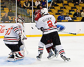 Chris Rawlings (NU - 37), Louis Leblanc (Harvard - 20), Drew Ellement (NU - 2) - The Northeastern University Huskies defeated the Harvard University Crimson 4-1 (EN) on Monday, February 8, 2010, at the TD Garden in Boston, Massachusetts, in the 2010 Beanpot consolation game.