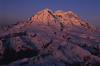 Aerial of sunset light and alpenglow highlighting Mount Rainier's summit.....Taken with Provia 100 film in 35mm format.