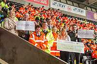 Stewards present £2000 of donations to Bone Marrow Cancer Research, Golau and Ty Hafan prior to kick off of the Premier League match between Swansea City and Burnley at the Liberty Stadium, Swansea, Wales, UK. Saturday 10 February 2018