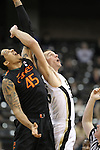 Miami (Fl) Hurricanes forward/center Julian Gamble (45) and Wake Forest Demon Deacons center Carson Desrosiers (33) fight for the ball. The score is tied at the half 37-37.