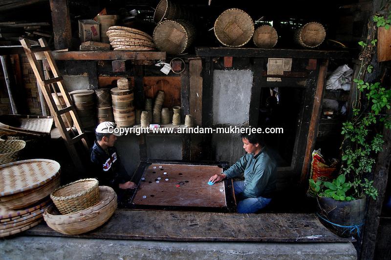 Young Bhutanese men playing carrom at a shop. Arindam Mukherjee..