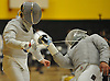 Ryan Baldi of Commack, left, and Nick Escobar of Brentwood duel in sabre during a boys fencing match at Commack High School on Friday, Dec. 2, 2016. Escobar won the bout 5-4.