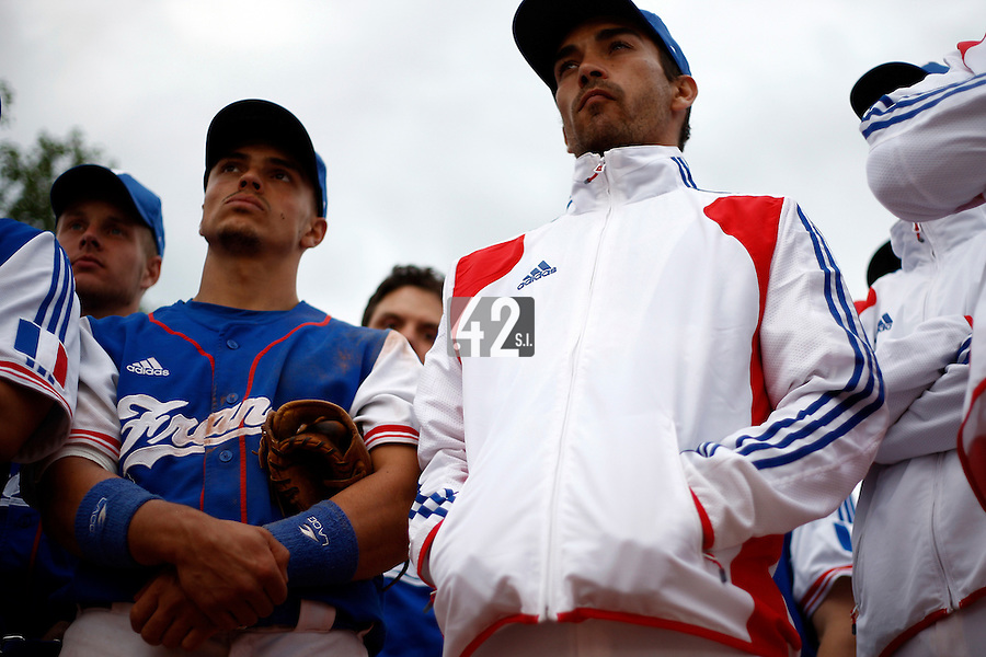 24 June 2011: Yann Dal Zotto and Thomas Meley listen as Team France manager Fabien Proust talks to his players after France 8-5 win over UCLA Alumni, at the 2011 Prague Baseball Week, in Prague, Czech Republic.