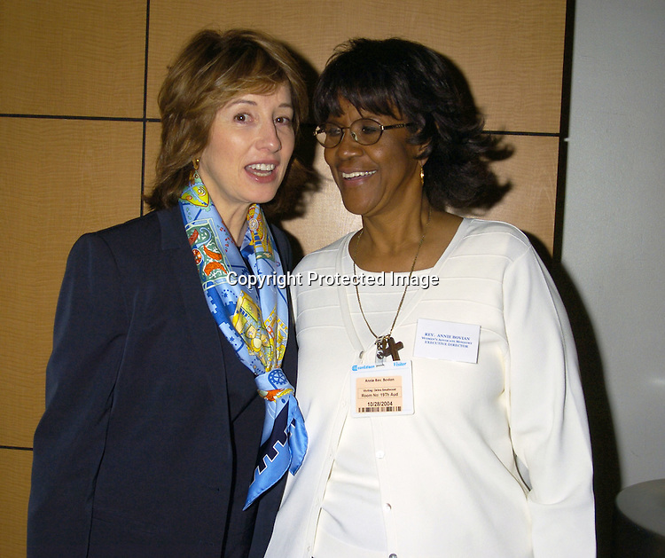 Maureen Garrett and Rev. Annie M Bovian..at the Women's Advocate Ministry Awards Breakfast on October 28, 2004 at the Con Edison Executive Dining Room. ..Photo by Robin Platzer, Twin Images