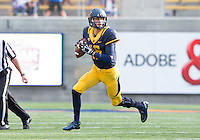 Saturday, November 2nd, 2013: California's Jared Goff runs to find his open receiver during a game against Arizona at Memorial Stadium, Berkeley, Final Score: Arizona defeated California 33-28