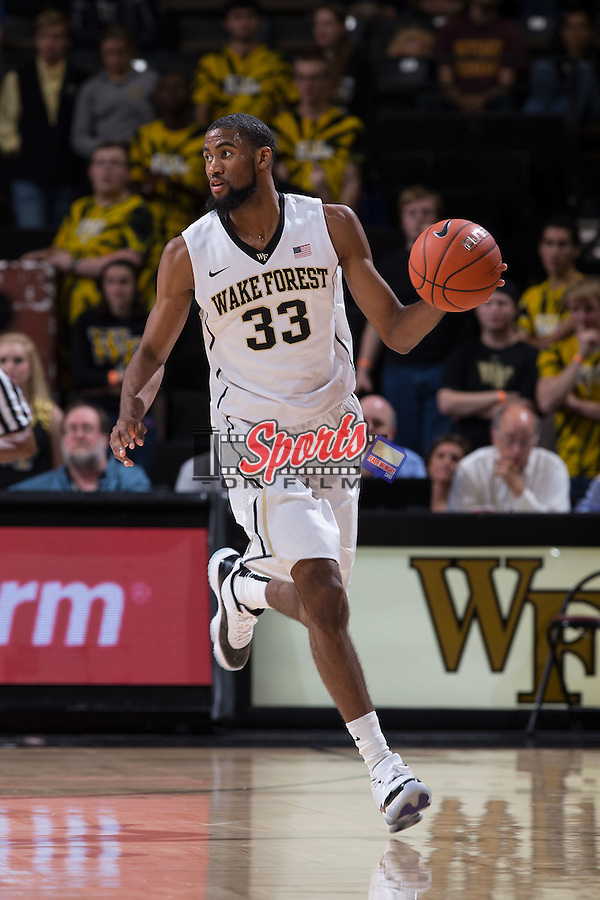 Aaron Rountree III (33) of the Wake Forest Demon Deacons brings the ball up the court during second half action against the Minnesota Golden Gophers at the LJVM Coliseum on December 2, 2014 in Winston-Salem, North Carolina.  The Golden Gophers defeated the Demon Deacons 84-69. (Brian Westerholt/Sports On Film)