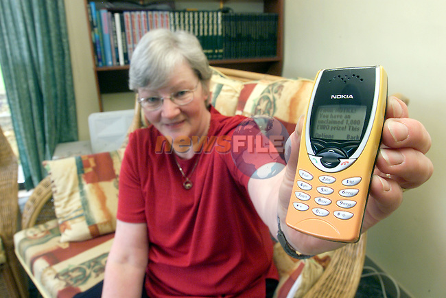 Gladis Carter from Brownstown Navan with the message on her mobile phone.Photo Fran Caffrey/Newsfile.ie..This picture has been sent to you by:.Newsfile Ltd,.3 The View,.Millmount Abbey,.Drogheda,.Co Meath..Ireland..Tel: +353-41-9871240.Fax: +353-41-9871260.GSM: +353-86-2500958.ISDN: +353-41-9871010.IP: 193.120.102.198.www.newsfile.ie..email: pictures@newsfile.ie..This picture has been sent by Fran Caffrey.francaffrey@newsfile.ie