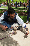 Jaison Tarin Titus takes a selfie with Bambi, a therapy dog from Go Team, a non-profit organization that trains therapy, crisis and service dogs, on the Lincoln Park Quad for Dogs on the Quad, an event hosted by the DePaul Activities Board and Health Promotion and Wellness team, Wednesday, May 31, 2017. Therapy dogs were on hand to help students deal with the stress and anxiety that often comes up during finals. The event was part of Brain Fuel Week, a week of events designed to help students de-stress as they head into finals. (DePaul University/Arielle Toub)