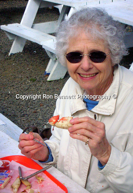 Donna Bennett eats Dungeness crab Lincoln Beach Oregon, eating crab, Dungeness crab, eating Dungeness crab, Oregon, Pacific Ocean, Plains, woods, mountains, rain, desert, rain, Rose City, Portland, Pacific Northwest, Fine Art Photography by Ron Bennett, Fine Art, Fine Art photography, Art Photography, Copyright RonBennettPhotography.com ©