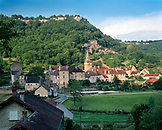 FRANCE, Baume les Messieurs, the village and 8th Century Abbey nestled at the base of steep rock faces, Jura Wine Region