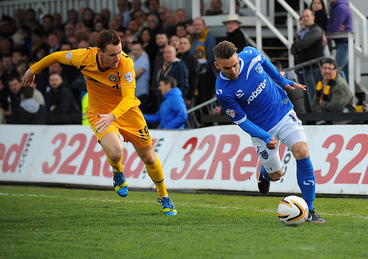 Portsmouth's Ricky Holmes under pressure from Newport County's Tom Naylor<br /> <br /> Photo by Kevin Barnes/CameraSport<br /> <br /> Football - The Football League Sky Bet League Two - Newport County AFC v Portsmouth - Saturday 29th March 2014 - Rodney Parade - Newport<br /> <br /> &copy; CameraSport - 43 Linden Ave. Countesthorpe. Leicester. England. LE8 5PG - Tel: +44 (0) 116 277 4147 - admin@camerasport.com - www.camerasport.com