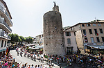 The peloton pass l'Horloge d'Anduze at the start of Stage 16 of the 2019 Tour de France running 177km from Nimes to Nimes, France. 23rd July 2019.<br /> Picture: ASO/Alex Broadway | Cyclefile<br /> All photos usage must carry mandatory copyright credit (© Cyclefile | ASO/Alex Broadway)