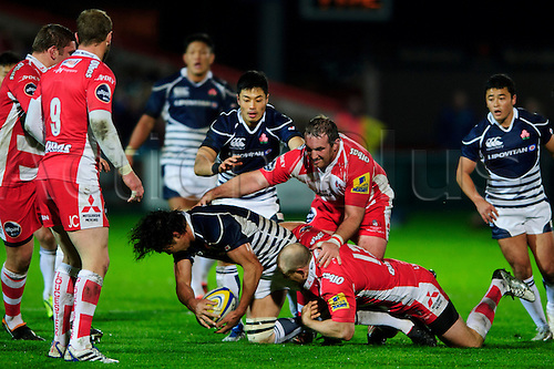 12.11.2013 Gloucester, England. Japan Lock (#5) Shoji Ito is tackled by Gloucester Inside Centre (#12) Mike Tindall during the first half of the International Friendly Rugby Union match between Gloucester Rugby and Japan at Kingsholm Stadium.