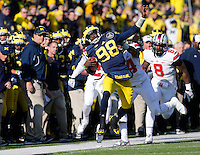 Ohio State Buckeyes linebacker Curtis Grant (14) pushes Michigan Wolverines quarterback Devin Gardner (98) out of bounds as he runs the ball in the second quarter of the college football game between the Ohio State Buckeyes and the Michigan Wolverines at Michigan Stadium in Ann Arbor, MI, Saturday afternoon, November 30, 2013. The Ohio State Buckeyes defeated the Michigan Wolverines 42 - 41. (The Columbus Dispatch / Eamon Queeney)