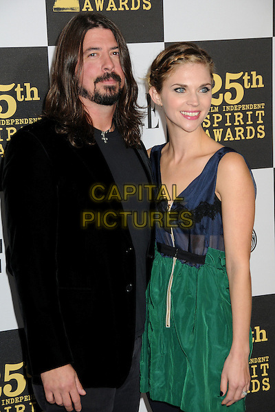 DAVE GROHL of the Foo Fighters & JORDYN BLUM.25th Annual Film Independent Spirit Awards - Arrivals held at the Nokia Event Deck at L.A. Live, Los Angeles, California, USA..March 5th, 2010.half length suit jacket blue green dress  black beard facial hair married husband wife .CAP/ADM/BP.©Byron Purvis/AdMedia/Capital Pictures.