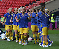 Women's Olympic Football match France v Sweden on 3.8.12...Close team spirit with the Swedish team before the Women's Olympic Football match between France v Sweden at Hampden Park, Glasgow.............