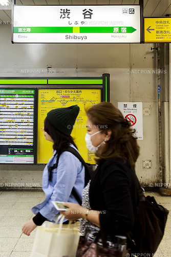 JR East commuters walk past a Shibuya station signboard on April 27, 2016, Tokyo, Japan, East Japan Railway Co. will start adding letters and numbers to station signboards to make it easier for foreigners to travel by train. JR East plans to completely update its station signboards and other displays by the end of the year. Tokyo Metro and other railway companies have already modified their station signboards. Tokyo will host the 2020 Olympic and Paralympics Games. (Photo by Rodrigo Reyes Marin/AFLO)