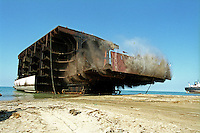 A ship is demolished at the Gaddani ship-breaking yard.