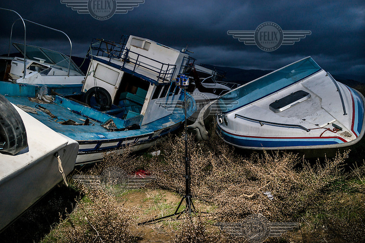 A virtual reality camera rig mounted in waste area of land where salvaged boats that would have carried refugees from Turkey are scrapped.