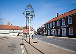 Village sign and historic buildings in Wickham Market, Suffolk, England