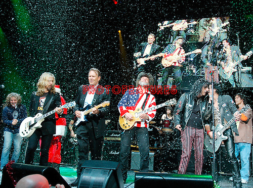 Tommy Shaw, Glen Campbell, Ted Nugent and Alice Cooper  at Alice Cooper's Christmas Pudding show for his Solid Rock Foundation Charity at Dodge Theatre in Phoenix, Arizona, December 18th 2004. Photo by Chris Walter/Photofeatures.