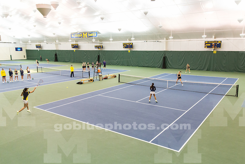 The University of Michigan women's tennis team hosts Northwestern at the Varsity Tennis Center in Ann Arbor, Mich., on April 5, 2014.