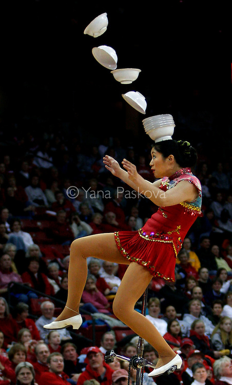 A Chinese performer hopes plates will find a precarious balance on her head during the halftime show of the Wisconsin vs. Minnesota women's basketball game on Feb. 20, 2006.