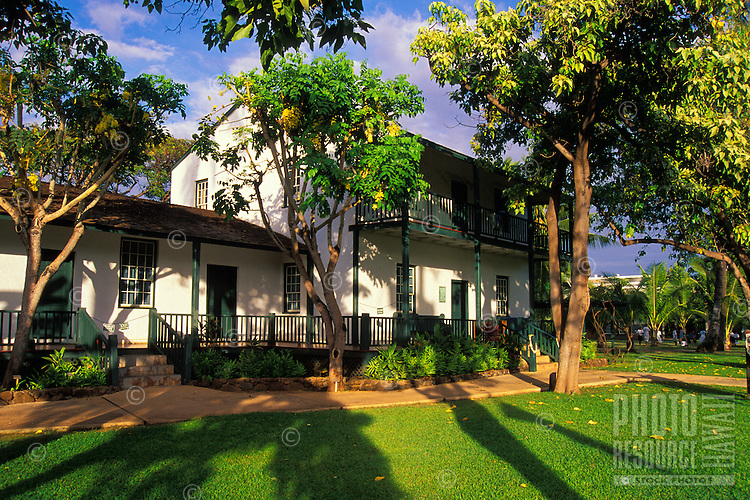 Late afternoon light falls on the original missionary home and museum of the Rev. Dwight Baldwin. Built in 1834, they can be visited on Front Street in Lahaina.