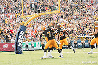September 7, 2009; Hamilton, ON, CAN; Hamilton Tiger-Cats linebacker Ray Mariuz (44) celebrates a touchdown with defensive back Bo Smith (7) and defensive back Lawrence Gordon (29) that was called back on penalties. CFL football - the Labour Day Classic - Toronto Argonauts vs. Hamilton Tiger-Cats at Ivor Wynne Stadium. The Tiger-Cats defeated the Argos 34-15. Mandatory Credit: Ron Scheffler.