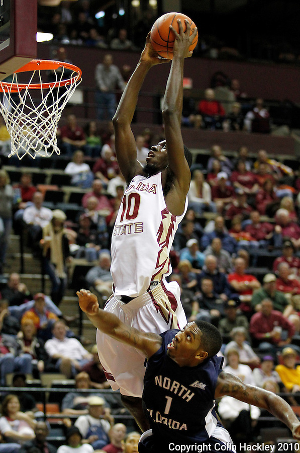 TALLAHASSEE, FL 11/12/10-FSU-ASU MBB 111210 CH-Florida State's Okaro White dunks over North Florida's Brad Haugarook during first half action Friday at the Donald L. Tucker Center in Tallahassee. .COLIN HACKLEY PHOTO