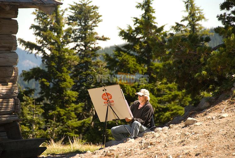 Artist drawing a mountain landscape scene
