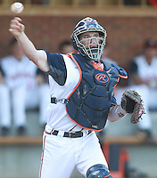 Virginia catcher Robbie Coman (8) throws to first base for the out against George Washington during the game Wednesday at Davenport Stadium in Charlottesville, VA. Photo/The Daily Progress/Andrew Shurtleff
