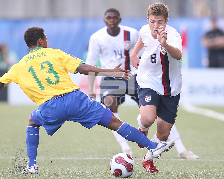 Robbie Rogers rushes past Amaral. USA stunned Brazil, winning 2-1 to finish first in their group. Final game in group D in Ottawa, Ontario, on JULY 6 2007.